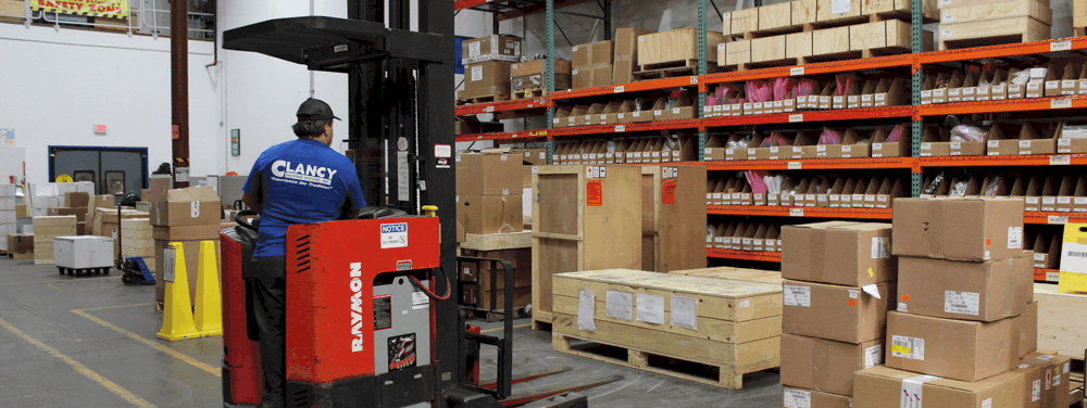 Clancy team member on forklift in warehouse
