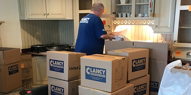 Clancy movers packing kitchen