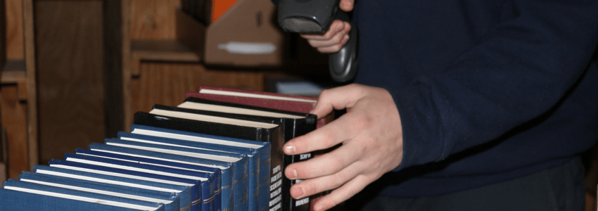 person scanning library books